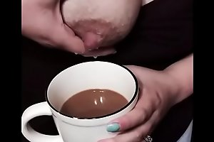 Lactating big tit mom squeezes breast milk into coffee