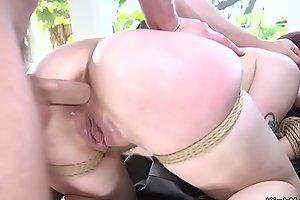 Guy anal fucks redhead in rope bondage