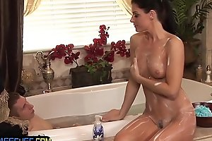 MILF masseuse plays with customers cock