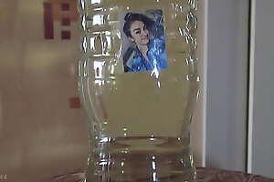 Slave drinking large bottle of Katrina's piss